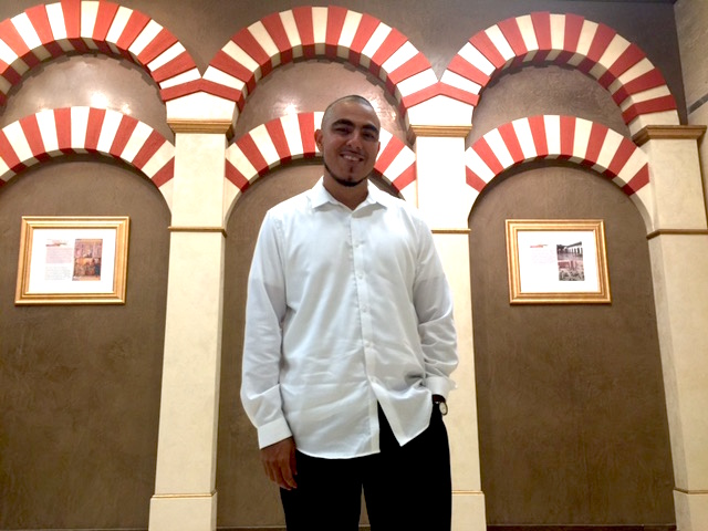 Founder of Islam in Spanish, Mujahid Fletcher stands in the center's exhibit that chronicles Spain's Moorish history.