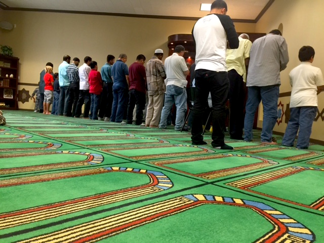 Juan Pablo Osorio (right) prays at Islam in Spanish after converting to Islam one year ago.