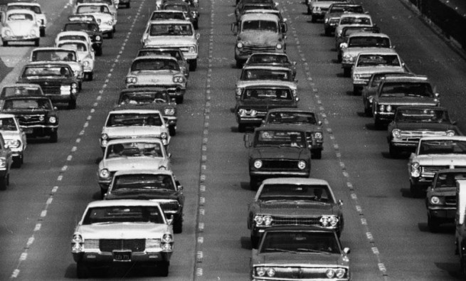Vintage cars sitting in traffic