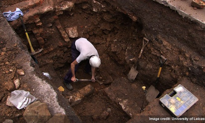 Man working in an archaeological dig site