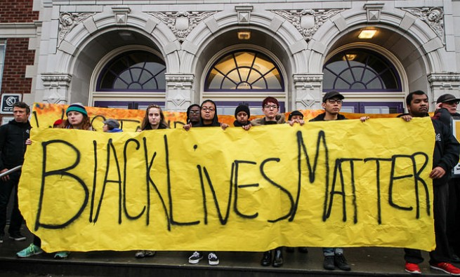 "Photo of young people holding a ""Black Lives Matter"" sign"