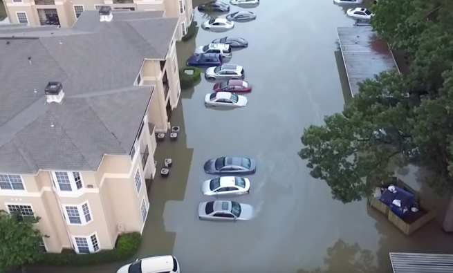 Flooded apartment building and cars