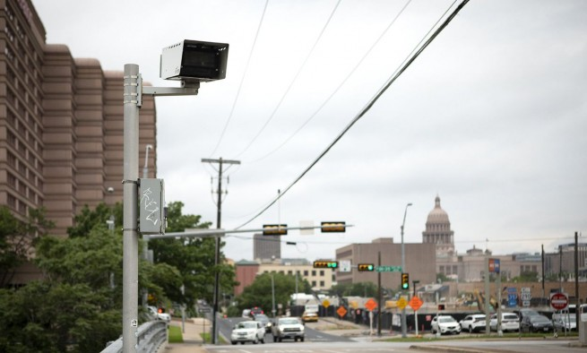A red-light camera at the intersection of Interstate 35 and 11th Street near downtown Austin.
