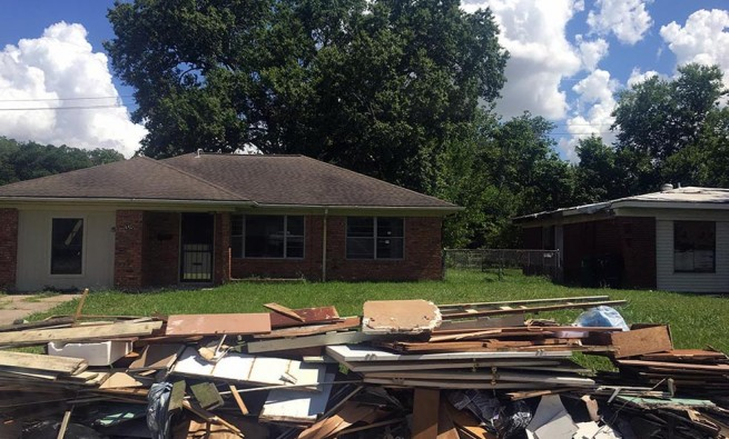 Pile of debris in front of Independence Heights home affected by Hurricane Harvey