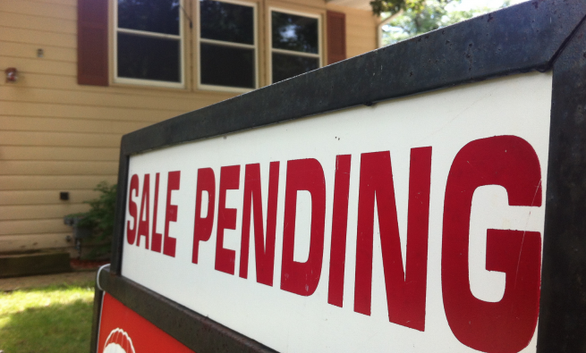 Sale Pending sign in front of home