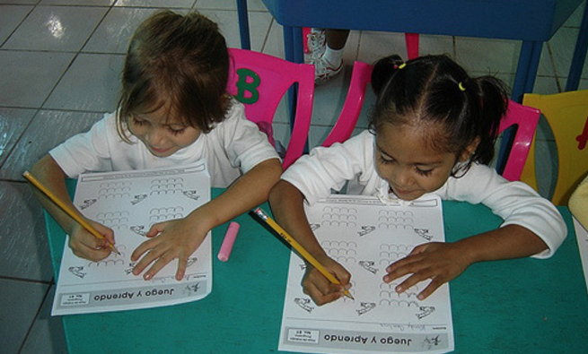 Students filling out worksheets