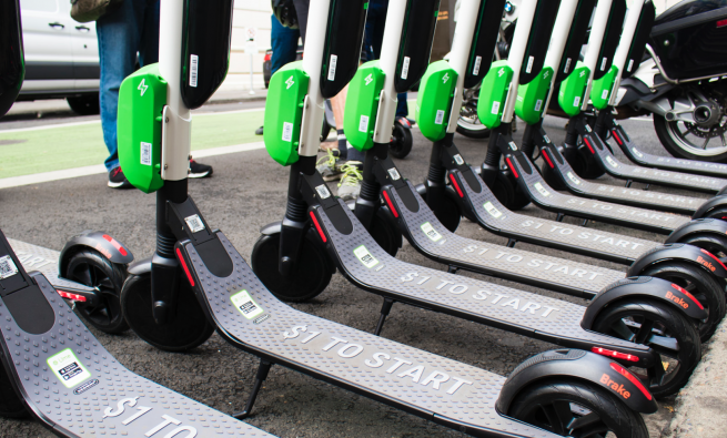 Row of dockless scooters