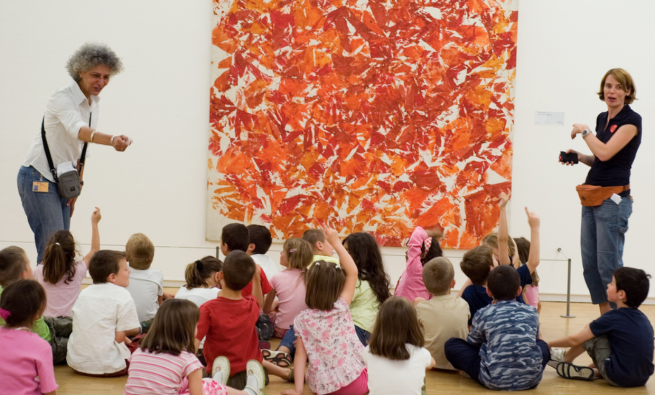 Kids sit in front of painting