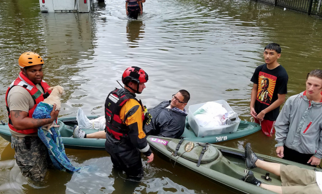 Men in a boat during a flood