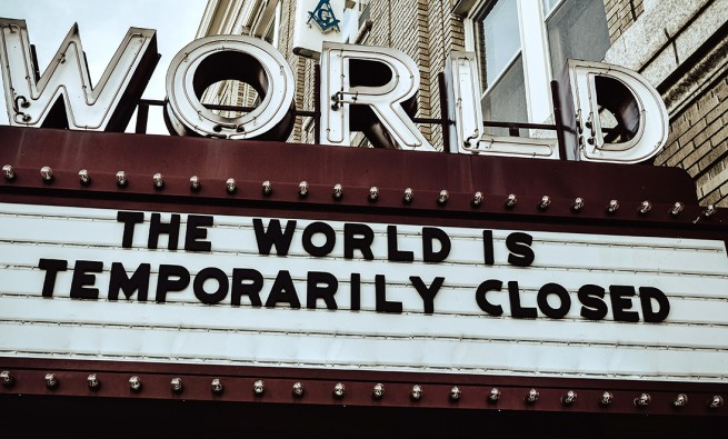 theater marquee reading the world is temporarily closed