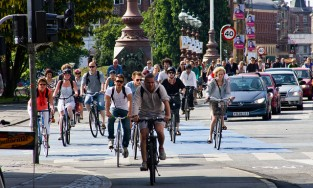 Copenhagen residents bicycle through the city. Image via flickr/Colville-Andersen.