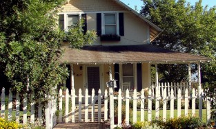 Home with a white picket fence in the front yard