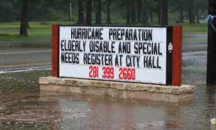 """Sign during flood saying """"Hurricane preparation"""" help lines"""