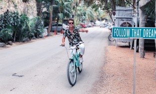 A man on a bicycle is following that dream