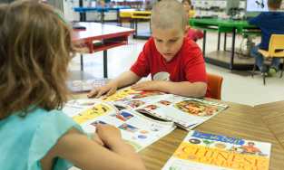 Students in classroom reading books
