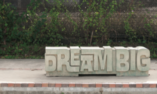 "Image of bench in East End that says ""Dream Big"""