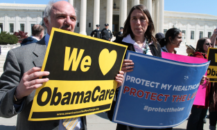 People in support of the ACA at a health care rally 2012