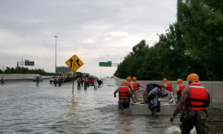 People wade through flood waters during Hurricane Harvey.
