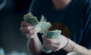 Woman counting money cash