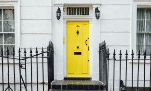 Yellow door to a house